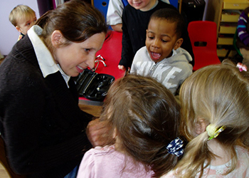 Pre-schoolers learning computing at their computer suit.